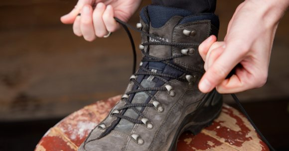 Image of lacing hiking shoes