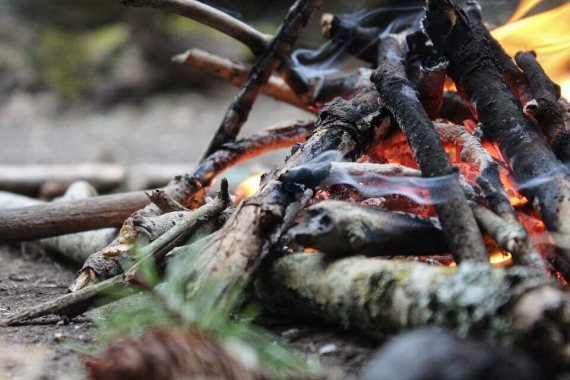 Image of how to use a wood burning stove in your tent